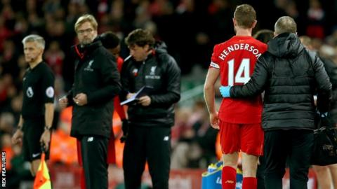 Jordan Henderson goes off injured against Manchester City