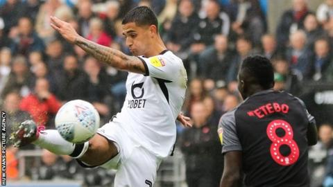 Yan Dhanda takes a shot for Swansea City