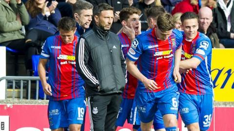 Aberdeen manager Derek McInnes in amongst the celebrating Caley players