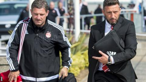 Aberdeen assistant Tony Docherty and manager Derek McInnes at Aberdeen Airport
