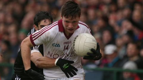 Kilcoo defender Niall Branagan challenges Slaughtneil's Se McGuigan during the big match at the Athletic Grounds