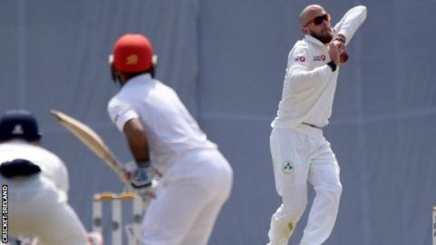 Spinner James Cameron-Dow in action on day two against Afghanistan