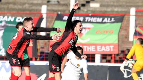 A delighted Conor McMenamin seals a 2-0 win for Glentoran against Carrick Rangers at the Oval