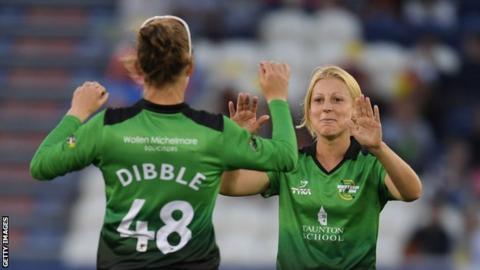 Claire Nicholas celebrates taking a wicket