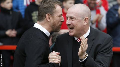 Gary Rowett (left) in his first match in charge of derby shakes hands with Mark Warburton, who took charge of Nottingham Forest for the first time