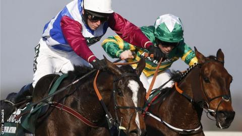 Derek Fox riding One For Arthur (L) clear the last to win The Grand National