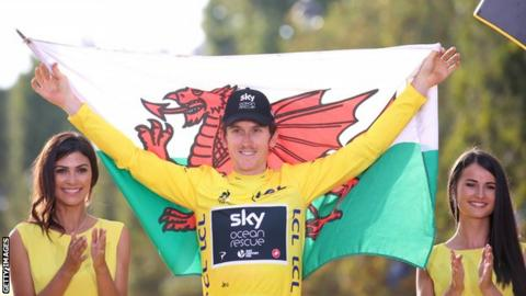 Geraint Thomas with Welsh flag on the podium