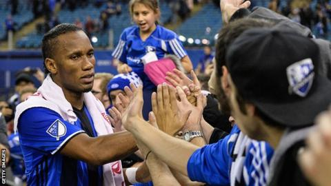 Didier Drogba greets the crowd