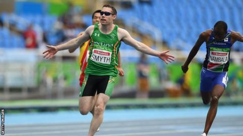 Jason Smyth celebrates after winning a third successive T13 100m title
