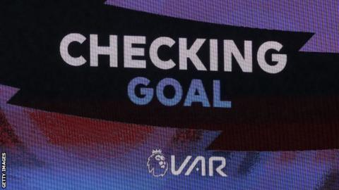 Technology A screen announcing VAR decision
