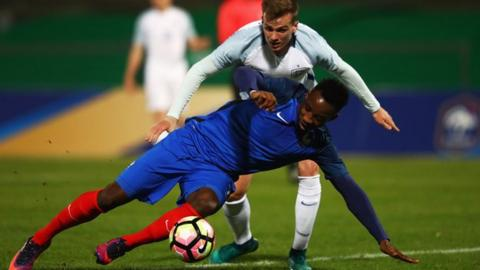 Moussa Dembele of France Under-21s and Rob Holding of England Under-21s