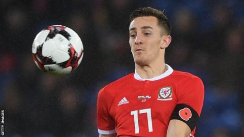 Tom Lockyer keeps his eyes on the ball on his senior Wales debut