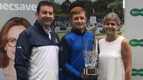 Ronan Mullarney received the NI Amateur Open trophy from Galgorm Castle captain Peter Daly and Valerie Penney from Specsavers Ballymena