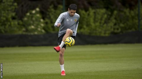 Pedro Neto practises with a football
