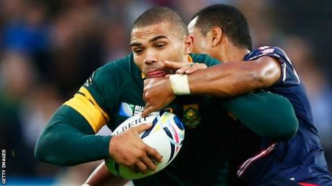 Bryan Habana of South Africa is tackled by Shalom Suniula of the United States