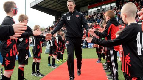 Stephen Baxter gets a guard of honour at Seaview after Crusaders won the Premiership title