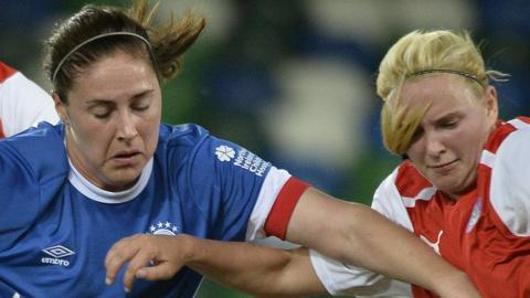 Linfield's Sarah Venney competes against Cliftonville opponent Chelsea Edwards at Windsor Park