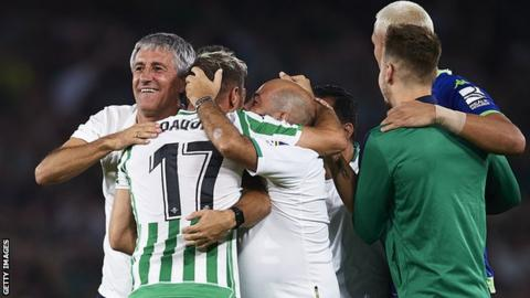 Quique Setien celebrates beating Sevilla with his Real Betis players
