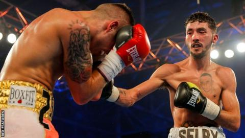 Andrew Selby in action against Louis Norman
