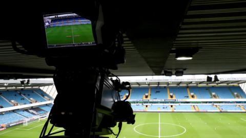 View of empty stadium with a TV camera in shot