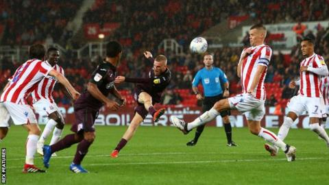Substitute Oli McBurnie almost snatched an equaliser for Swansea at Stoke