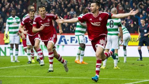 Paul Quinn celebrates after scoring for Celtic against Aberdeen