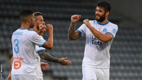 Marseille players celebrate a goal in a friendly against Nimes