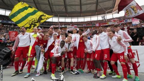 RB Leipzig players celebrate after a 4-1 win over Hertha Berlin secured a place in next season's Champions League group stage
