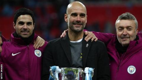 Pep Guardiola celebrates his first major trophy as Manchester City boss with his assistants Mikel Arteta and Domenec Torren
