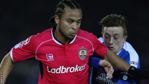 Curtis Thompson holds off an opponent during a Notts County match