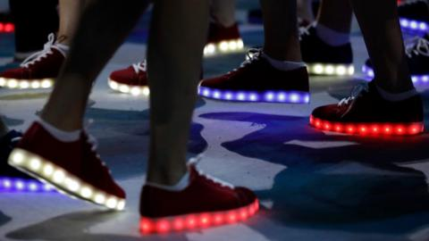 British athletes wear glooming shoes during the closing ceremony in the Maracana stadium at the 2016 Summer Olympics in Rio de Janeiro, Brazil, Sunday, Aug. 21, 2016