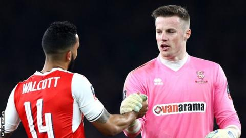 Theo Walcott & Paul Farman shake hands after their FA Cup quarter-final match