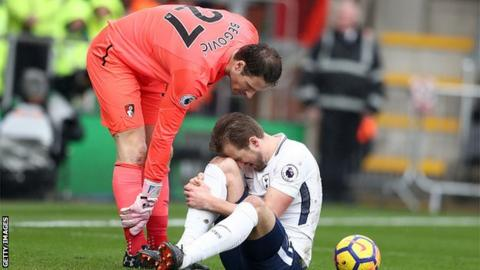 Harry Kane is down injured against Bournemouth