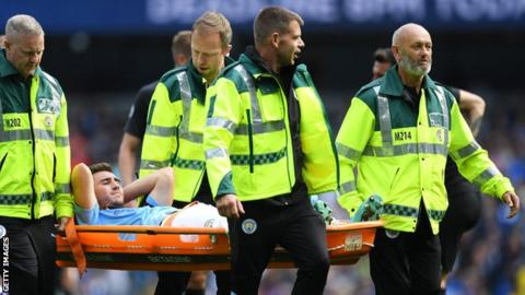 Manchester City player Aymeric Laporte leaves the Etihad field on a stretcher after suffering an injury in the game against Brighton