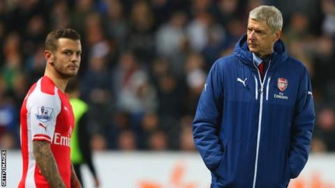 Arsenal manager Arsene Wenger (right) and Jack Wilshere