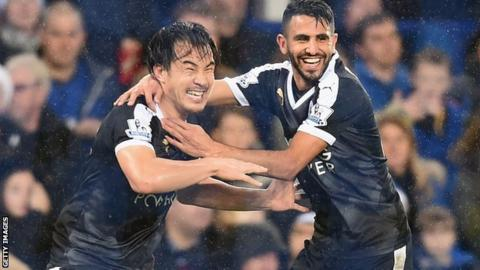 Shinji Okazaki and Riyad Mahrez celebrate Leicester's third goal