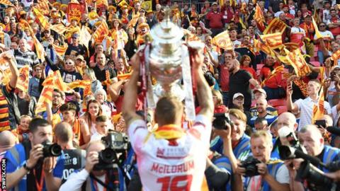 Michael McIlorum lifts the cup for the Catalans supporters