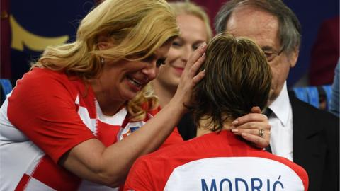 Croatia president Kolinda Grabar-Kitarovic embraces Luka Modric after the World Cup final