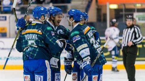 Fife Flyers players celebrate their Challenge Cup victory over Dundee Stars on Saturday.
