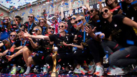 """Members of the World Cup-winning US women's team take part in a ticker tape parade for the women's World Cup champions on July 10, 2019 in New York. - Tens of thousands of fans are poised to pack the streets of New York on Wednesday to salute the World Cup-winning US women's team in a ticker-tape parade. Four years after roaring fans lined the route of Lower Manhattan's fabled """"Canyon of Heroes"""" to cheer the US women winning the 2015 World Cup, the Big Apple is poised for another raucous celebration. (Photo by Johannes EISELE / AFP) (Photo credit should read JOHANNES EISELE/AFP/Getty Images)"""