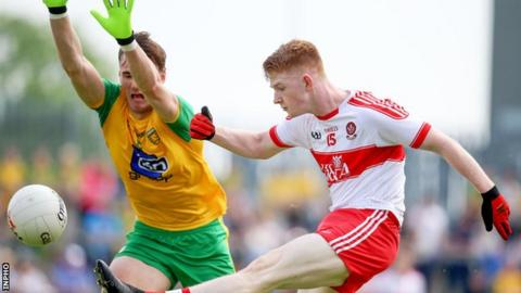 The block comes in as Derry forward Declan Cassidy goes for a point in the quarter-final against Donegal