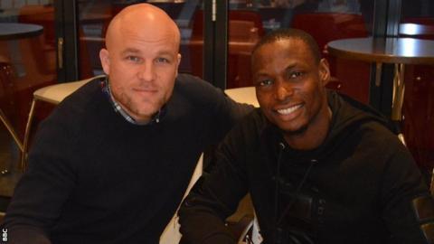 Mainz sporting director Rouven Schröder and Nigeria striker Anthony Ujah