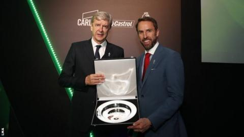 Arsene Wenger is presented with his LMA award by Gareth Southgate