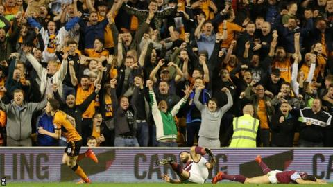 Wolves fans celebrate their opening goal against Aston Villa