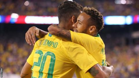 Roberto Firmino and Neymar embrace after the Liverpool forward scored the opener