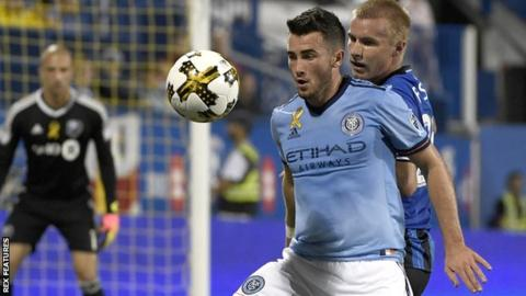 New York City midfielder Jack Harrison shields the ball from Montreal Impact defender Kyle Fisher