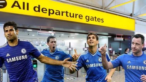 Chelsea players near the departure gate