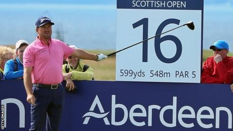 McDowell warns spectators of an errant drive in the final round