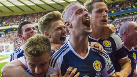 Scotland celebrate a Leigh Griffiths goal against England in their World Cup qualifier in June 2017