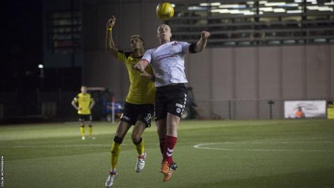 City attacker Ousman See (left) and Clyde defender Chris Smith battle for the ball during the second-half as both team seek a winning goal.